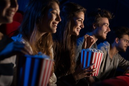 (c) StockPhotoPro - Group of friends in the movie theater