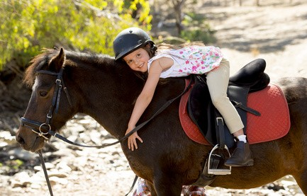 (c) Focus Pokus LTD - happy child girl with pony horse as young jockey in Summer (Microstock Bildagentur Fotolia.de)